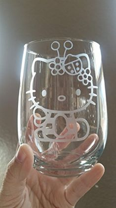 This is a hand etched Hello Kitty Bumble Bee inspired stemless wine glass. Its a chemical etch which means that no matter how many times you wash it, it will never fade! The glass is heat treated a… Hello Kitty Wine, Hello Kitty Kitchen, Pink Hello Kitty, Hello Kitty Items, Hello Kitty Accessories, Hello Kitty Collection, White Wine, Red Wine, I Love Cats
