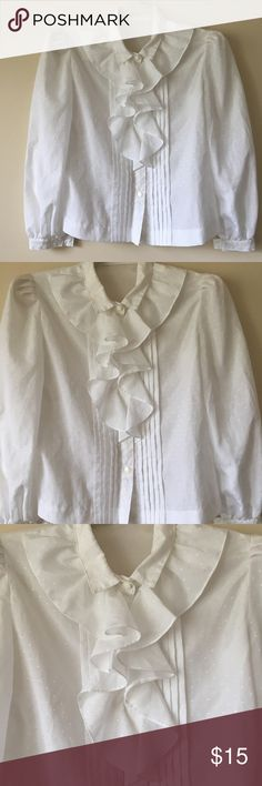 """Vintage White Jabot Ruffle Cross Embroidery Top Absolutely beautiful vintage Blouse! Small white embroidered crosses (plus signs?) on the entire top. Gorgeous ruffles on the front, small shoulder pads. No size tag, may have even been handmade. Please consider measurements-Pit-Pit-17"""", Sleeve-20"""", Length-20"""". Live long and poshper 🖖🏼 Tops Blouses"""