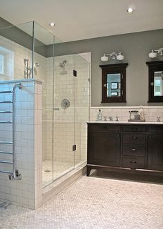 White/Cream/NeutralSubway Tile-shower & floor. Teal/blue paint. Black Vanity & MirrorsClick to check a cool blog!