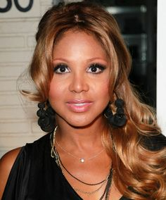 Toni Braxton channeled Brigitte Bardot with this tousled, sun-kissed 'do, falling over one shoulder.