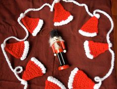 Santa hat garland crochet pattern.                                                                                                                                                                                 More