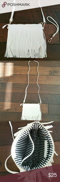 """Fringe Crossbody Bag - No Offers @blushonme at Poshmark   Fringe Crossbody Bag - White   Featuring a vegan leather crossbody bag that can also be use as a wristlet. Fringes on both sides. One main compartment with side zipper, and side open slot. Detachable straps.   Approx Measurements -  Length - 5 3/4"""" Width - 2 3/4"""" Across - 8"""" Shoulder strap drop - 24.5""""  ● PRICE IS FIRM ● Brand new in original package. Bags Crossbody Bags"""