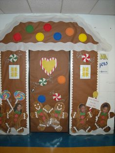 Gingerbread house Christmas classroom door cover. Made with paper, painted paper plates covered with plastic wrap.