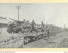 PORT TEWFIK, SUEZ. 1942-02. BREN GUN CARRIERS OF THE 19TH AUSTRALIAN INFANTRY BRIGADE AND CREWS ARRIVING ON TRAINS BEFORE THEIR EMBARKATION.