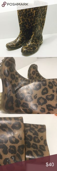 COACH Leopard Pixy Rain Boots 7 COACH Leopard Pixy Rain Boots 7 preowned.  Shows signs of normal wear when held up to light. Other than that can't tell.  missing 1 inside insole pad. See photos loved these. Still looks great! Coach Shoes Winter & Rain Boots