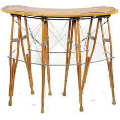 The Crutch Upcycled Bar Table is a statement piece that uses a discredited object: crutches. It is a sturdy and elegant piece. By Rodney Allen Trice.