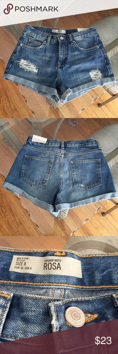 Topshop Moto Distressed Cuffed Rosa Shorts 4  NWT Topshop Moto Rosa distressed, cuffed jeans shorts in size 4. Mid blue wash, made from 100% cotton. Rise is not 9.75 and inseam is 2.75. Please ask if you have any questions. Topshop Shorts Jean Shorts