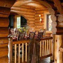 A cozy dining nook adds to the charm of this Hiawatha log home.