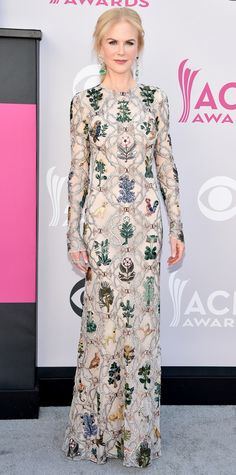 Nicole Kidman wore the most Nicole Kidman gown to the 52nd Academy of Country Music Awards. The stunning Alexander McQueen gown features allover victorian floral embroidered tulle. Leave it to Kidman and her team to find perfectly matching drop earrings to complete the look.