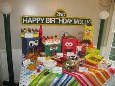 Including Sesame Street character risers to lift party food adds dimension to the table.  See more Elmo birthday party ideas at www.one-stop-party-ideas.com