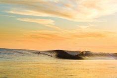 surfing at sun set
