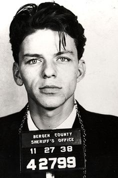"Frank ""Blue Eyes"" Sinatra poses for a mug shot after being arrested and charged with ""carrying on with a married woman"" in Bergen County, New Jersey in 1938.    Photo by Michael Ochs Archives. S)"