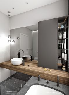 wood counter. grey tile. white raised bowl sink. copper fixtures. grey cabinet (both bathroom)
