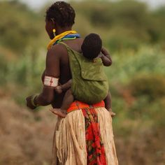 Babywearing mom with baby on her back in South Sudan