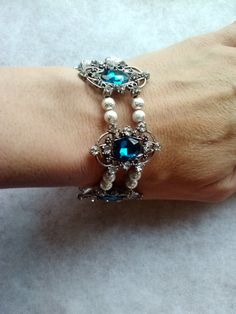 Check out this item in my Etsy shop https://www.etsy.com/listing/254185742/teal-glass-rhinestones-silver-stardust