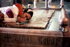 *JERUSALEM ~ CHURCH of the HOLY SEPULCHRE: Just inside the entrance to the church is the Stone of Anointing(also Stone of the Anointing or Stone of Unction),which tradition believes to be the spot where Jesus' body was prepared for burial by Joseph of Arimathea.