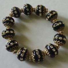 Gold and black chunky bracelet by THEACCESSORIEDOLL on Etsy