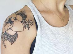 magnolia tattoo on shoulder