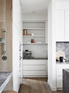 I'm particularly fond of this trend, because while we all enjoy an open-plan kitchen, we also want to be able to hide a little bit of mess once in awhile. Enter kitchens with a floor to ceiling island layout, creating a butler's pantry behind the main kitchen, and extra hidden counter space.