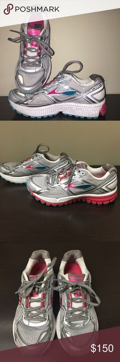 Gray pink and blue Brooks Ghost 8 running shoes Only worn once Brooks running shoes! Gray exterior with blue tel and pink emblem and soles! Brooks Shoes Athletic Shoes