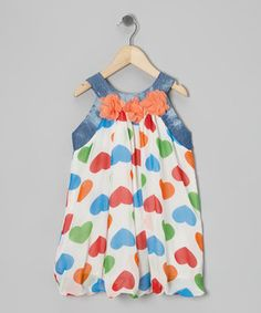 With charming hearts and lacy floral accents, this darling dress promises to tickle a little one's fashion funny bone. Plus, the airy fabric and denim trim guarantee it'll be a dream to don.
