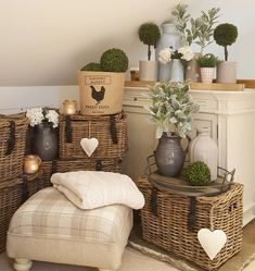 Wicker fishermans baskets....ceramic pitchers and topiary...lambs leaf adding a soft touch of greenery... Www.westbarninteriors.co.uk
