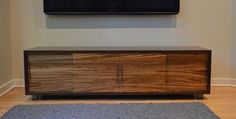 nFORMAL design - Symanski Media Console - This is a media console we designed, built and delivered to a family in Lincoln Park, Chicago. They were yet another great client...open to suggestion and letting us be creative. Console is dark stained walnut case, natural walnut partitions and shelves, and Zebrawood doors.