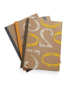 Painting isn't just for fabrics. A block-print technique can also dress up paper, like these notebooks printed with house numbers.
