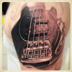 Guitar tattoo. Photo by kidkros • Instagram