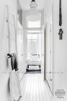 Entry with walls all in white. Great idea for small narrow hallways. Amazing home of Paulina Arcklin