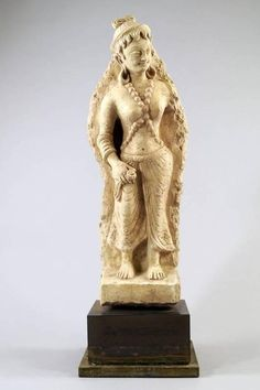 A Gandhara Stucco figure of a female attendant, 4th century, relief carved standing full length, nude top half, draped lower robe. From Private Japanese Collection. - Price Estimate: £1000 - £1500