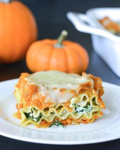 These Pumpkin and Spinach Lasagna Rolls are a quick and easy way to enjoy the comfort of lasagna. Packed with veggies, they are a great fall meal!