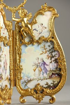 Miniature rococo style screen decorated with porcelain plates and ormolu mounts? A curious two-panel folding screen with gilded bronze mounts decorated with scrolls and a cherub bearing a medallion for attaching a miniature portrait. The screen is decorated with two...