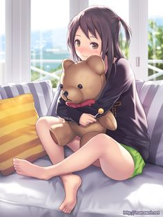 Anime girl holding her teddy bear.