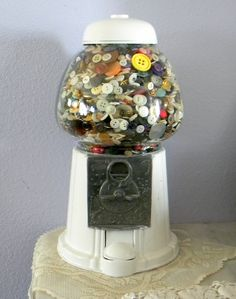 Vintage buttons stored with an old gumball machine and spray paint