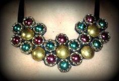 Another element in the family of the vintage button necklaces!