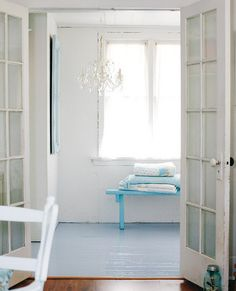 beachy shabby. . .reclaimed doors, ceramic knobs, blue painted on floors, blue bench, blue quilts