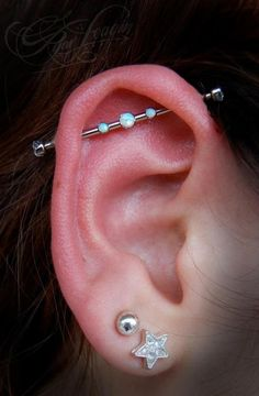 OK so this isn't a picture of my ear, but I got this exact industrial barbell with three opals on Saturday and I LOVEEE it!  Sooo pretty!
