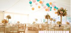 Teal, robin egg, peach and pink lanterns in wedding marquee - nice and bright, but maybe too summery for a fall wedding?