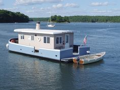 Charles Andrew joins Tessie Ann as part of a fleet of non-powered houseboats moored in Riggs Cove by Riggs Cove Rentals LLC at Robinhood Marine Center, a full service marina in Georgetown, Maine. Charles Andrew ...