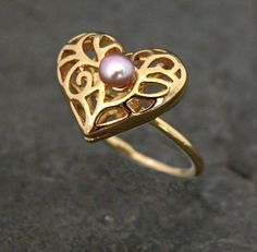 Check out this item in my Etsy shop https://www.etsy.com/listing/99378058/wedding-ring-gold-heart-ring-heart