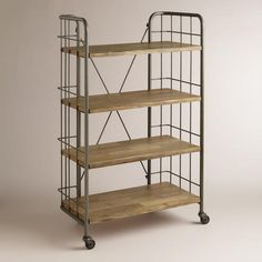 With ample shelf space, our Large Caiden Cart combines distressed wood and metal with a varied, rustic finish for an industrial feel. This substantial storage unit is a stylish addition to the home office or kitchen. Rustic Bookcase, Home Office Furniture Desk, Cabinet Shelving, Storage Cart, Toy Storage, Extra Storage, Affordable Home Decor, World Market, How To Distress Wood