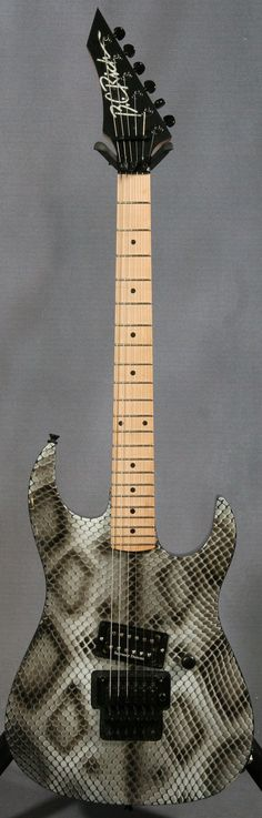 BC-Rich Gunslinger w/ snakeskin graphics. Deliciously over the top...