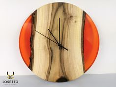 The wall clock is made of seasoned walnut wood protected with 2 layers of oil-wax and high-quality transparent red epoxy resin. This unique copy was made by hand with the utmost care and attention to detail. Black hands and a quiet flowing mechanism were installed - there is no loud ticking that disturbs falling asleep making the clock also suitable for hanging in the bedroom. The diameter is 34cm.