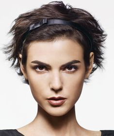 Distribute mousse through damp hair. Flip your head over & quickly blast hair with dryer, then tousle with your fingers. Push a thin headband 1-2 inches back into the hair (or cover hairline with a thicker band to camouflage oily roots.) Tease hair behind the band to prevent it from slipping. Apply styling cream to ends for shine.