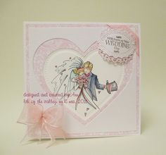 a simple cas card using mr and mrs stamp and paper from lotv, white linen card, distress ink, little B and spellbinder dies, satin and organza ribbon to complete.
