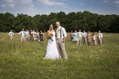 perfect shot of the wedding party in a field (photo: third line studios)