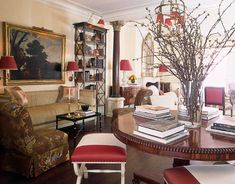 """""""Dividing the enormous living room in half with antique columns made it so cozy and versatile,"""" says Branca."""