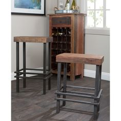 Give your home decor a unique accent with this Rover counter stool. Sturdily constructed of reclaimed pine wood and iron, this 24-inch stool is the perfect industrial accent to any home kitchen or bar.