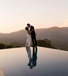 Thanks for taking us to the ends of the earth with you two! Loving this image from our Mia Bella Bride! #miabellabride #sheathdress #californiawedding #californiabride #westcoastwedding #infinitypool #wedding #weddingday #weddingfun